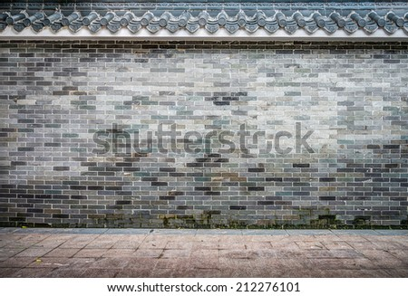 Old brick fence in Chinese style - stock photo