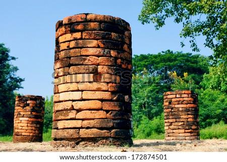 Old brick pillar - stock photo