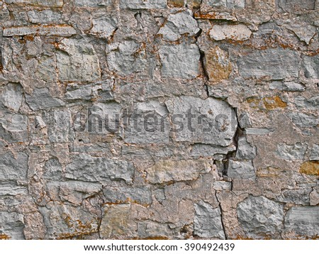 Old brick stone wall background, rural limestone stonewall texture - stock photo