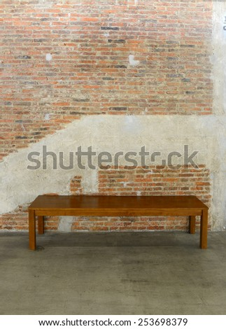 Old brick wall and concrete texture, background of decorate and Long wooden chair - stock photo