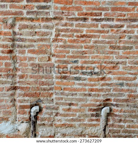 Old brick wall and pipe on concrete texture, background for decorate