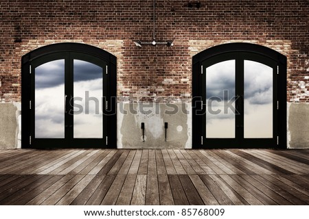 old brick wall and wooden floor with twin door - stock photo