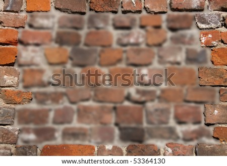 Old brick wall as a grungy frame - stock photo