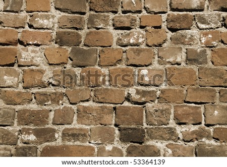 Old brick wall as background (sepia tone) - stock photo
