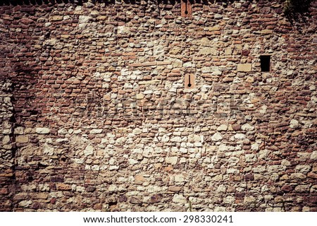 Old brick wall background in france - stock photo