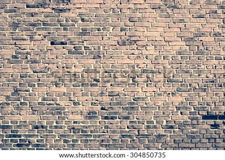 Old brick wall background.Vintage photo.