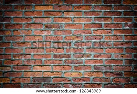 Old brick wall background with vignette