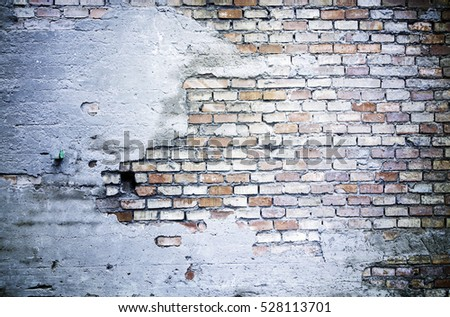 Old brick wall, detail of an old wall in ruins