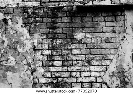 Old brick wall forming a frame (in black and white) - stock photo