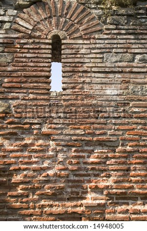 Old brick wall from third and beginning of the fourth centuries A.D.