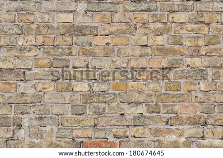 Old brick wall in a background image. - stock photo