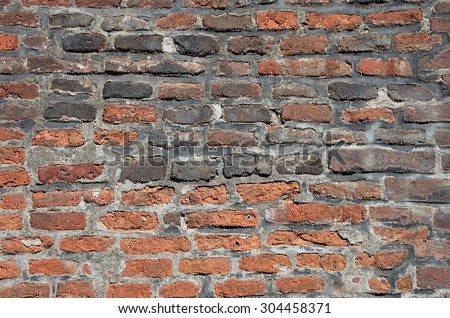 Old brick wall in Prague as textured background or backdrop. - stock photo
