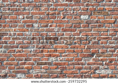 Old brick wall in various colors - stock photo