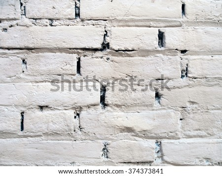 Old brick wall painted in white - stock photo