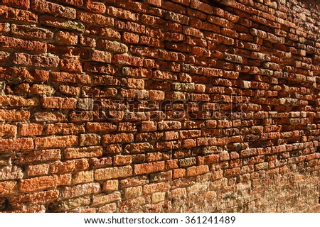Old brick wall perspective (Venice, Italy). A game of light and shadow. - stock photo