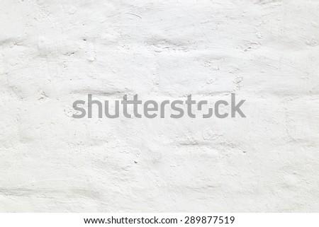 Old brick wall whitewashed background - stock photo