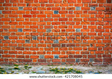 Old brick wall with a strip of ground below, background image - stock photo