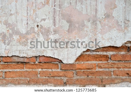 old brick wall with cracked stucco background