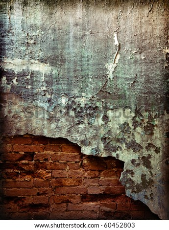 old brick wall with cracked stucco layer background - stock photo