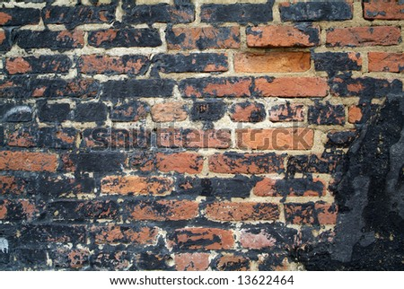 Old brick wall with grungy black over top