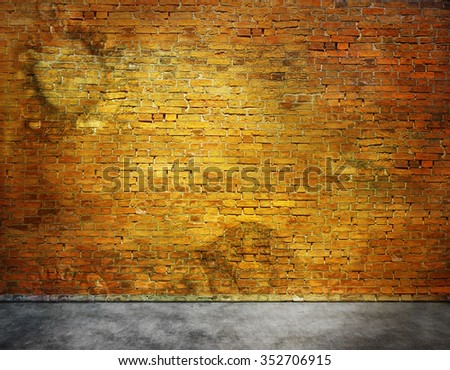 Old brick wall with stains with part of foreground - stock photo