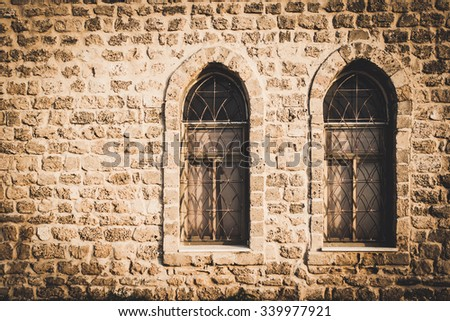 old brick wall with two windows, arabic style - stock photo