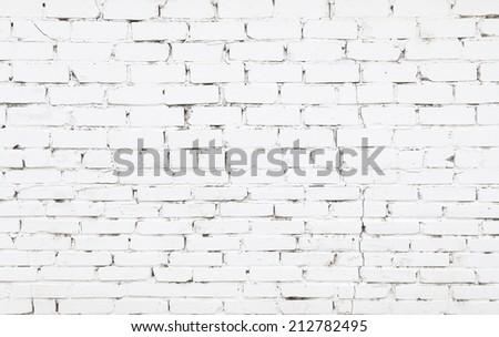 Old brick wall with white bricks - stock photo