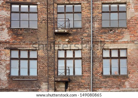 old brick wall with windows - stock photo