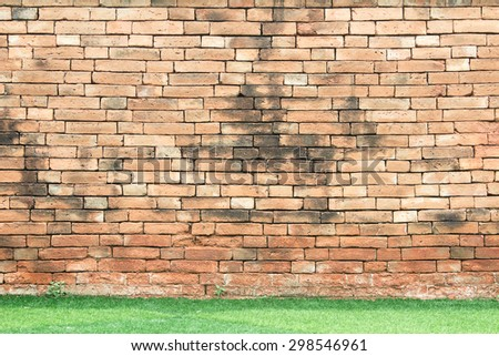 Old brick walls on the lawn - stock photo
