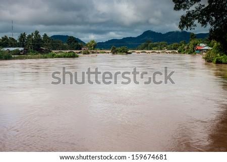 Old bridge between islands on Mekong river, Laos - stock photo