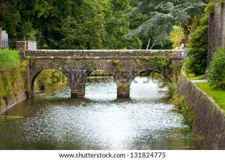 Old bridge in Castle des Ravalet (Chateau des Ravalet), Normandy, France - stock photo