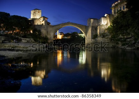Old Bridge in Mostar at night, Bosnia and Herzegovina. The bridge was reconstructed in 2003 after the original from 1556 - stock photo