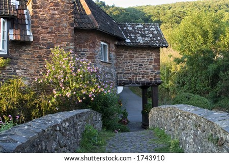 Old bridge leading to an old english cottage