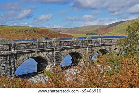 Old Bridge over reservoir in the Elan Valley Wales - stock photo