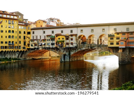 Old bridge (Ponte Vecchio) over Arno river at sunset, Florence, Italy - stock photo