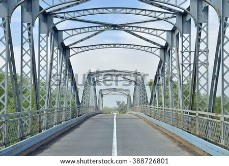 Old bridge with a metal construction - stock photo