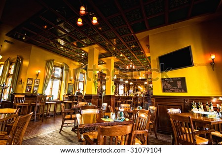 Old brittish pub interior - stock photo
