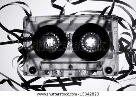 Old broken audio tape cassette - stock photo