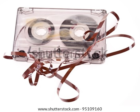 Old broken cassette isolated on white - stock photo