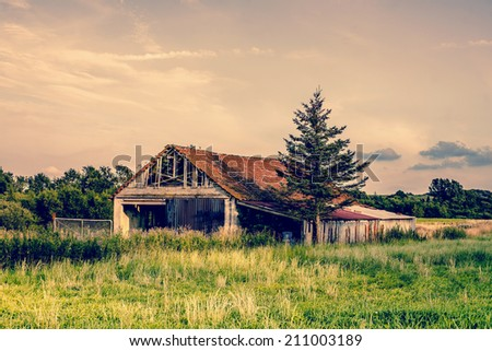 Old broken farm in the countryside - stock photo