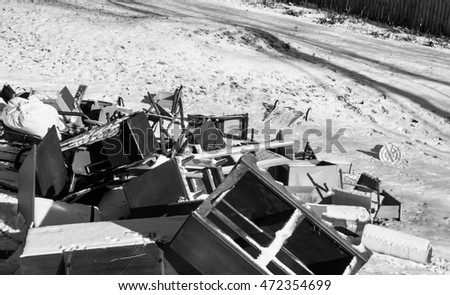 Old broken furniture thrown away on the snow