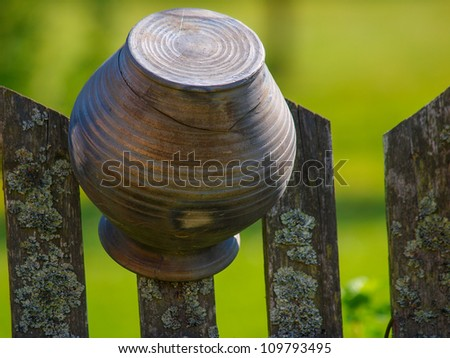 Old broken jars on the wooden fence - stock photo