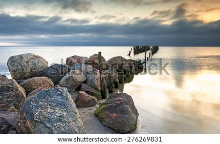 Old broken pier at dawn, Baltic Sea - stock photo
