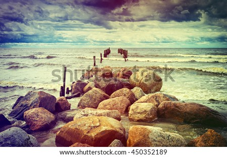 Old broken pier at the gulf of Riga, Baltic Sea. Image toned for inspiration of retro style