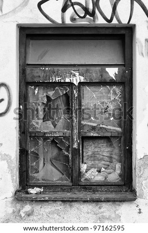 old broken window black and white - stock photo