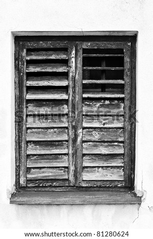 old broken window with wooden blinds, black and white - stock photo