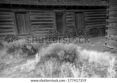 Old broken wood wheels, old wild West - stock photo