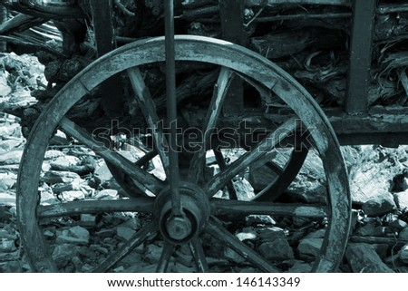 Old broken wooden cart with dry brushwood. Sepia - stock photo
