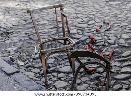 Old Broken Wooden Chair On The Sidewalk