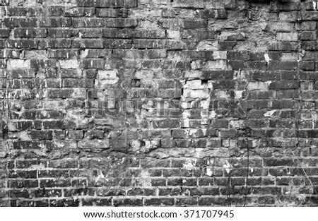 Old broken worn industrial brick wall texture background. - stock photo